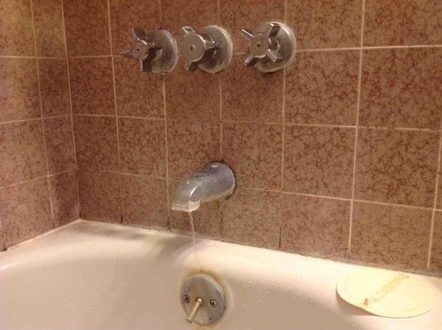 Orange, CA - Clear slow draining bathtub drain in hallway bathroom