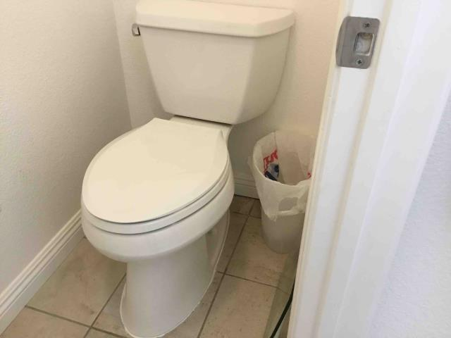 Placentia, CA - Clear clogged toilet by removing toilet and cables through toilet flange; reset toilet with new wax ring