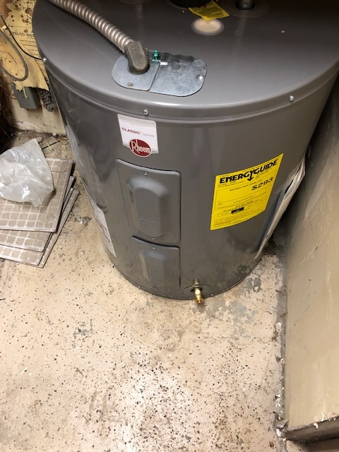 Tustin, CA - Water heater on east end just installed could put a pan and pipe to outside onto walkway. West side water heater is installed next to a floor drain no need to put a pan