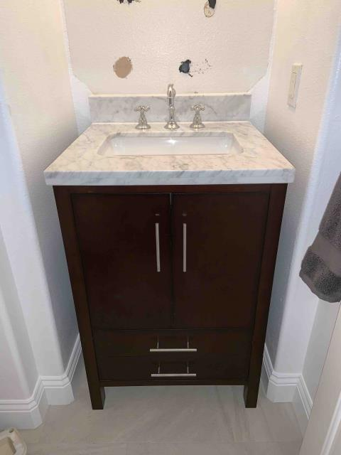 Villa Park, CA - Install new customer supplied vanity in hallway bathroom, cut open wall and move sink drain up, install new 2 inch cleanout, install new customer supplied faucet, p-trap
