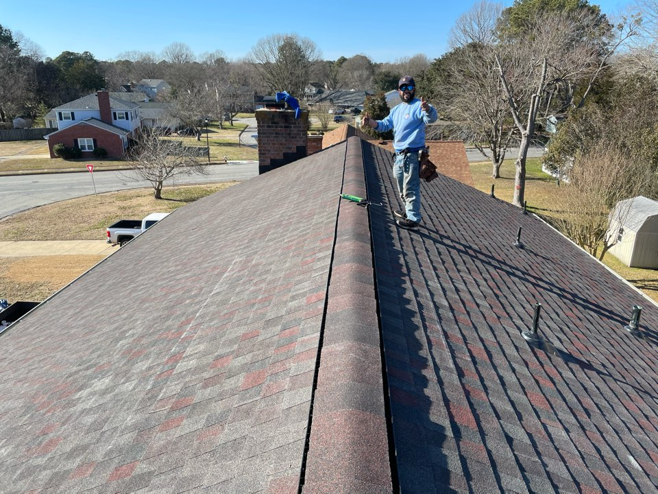 Hampton, VA - •Just completed a new roof installation using GAF Timberline HDZ AH lifetime warranty color midnight blush with underlinement of GAF Felt Buster High Traction synthetic roofing felt and cobra rigidvent3 for more air air flow in the house