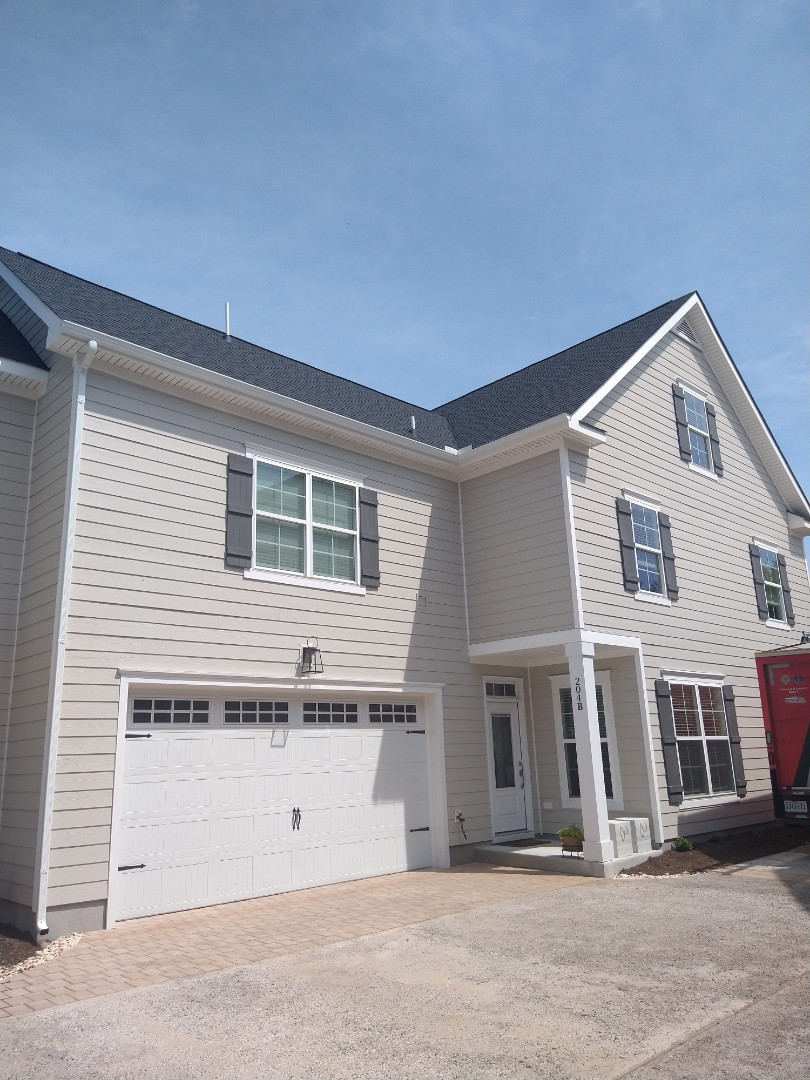 Virginia Beach, VA - New gutter white color and downspouts 2x3 and gutters guard