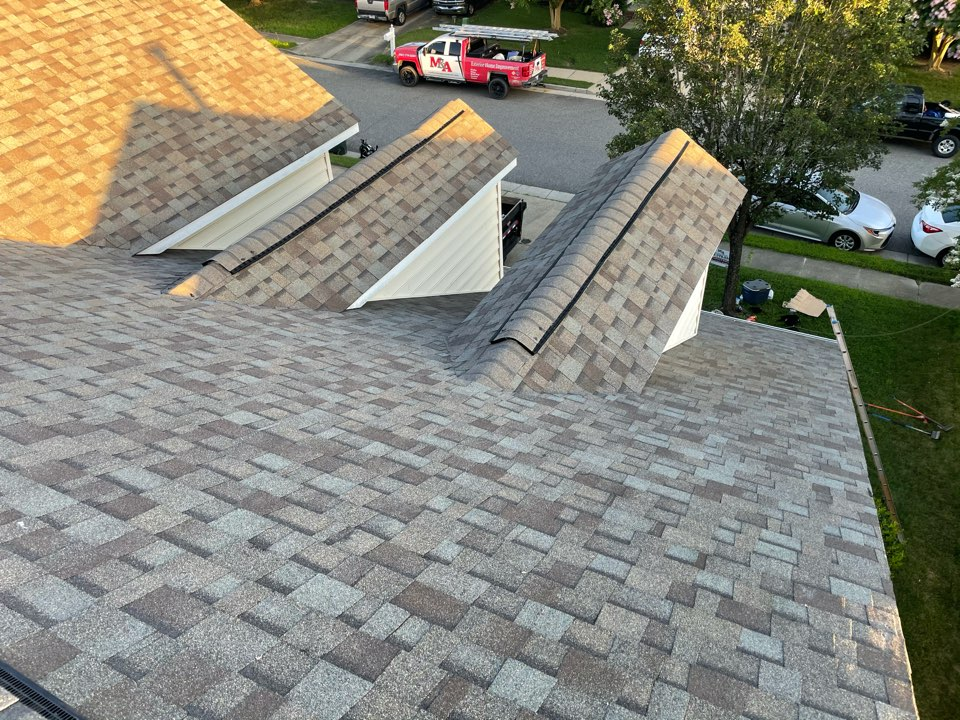 Suffolk, VA - Just completed a new roof installation using Owens Conning Duration HD lifetime warranty color Diftwood  with underlinement of U20 Felt Buster High Traction synthetic roofing felt and cobra rigidvent3 for more air air flow in the house