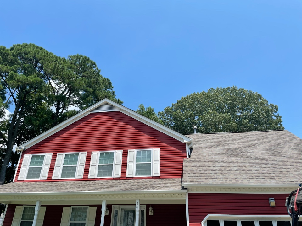 Hampton, VA - Just completed a new roof installation using Owens Conning Duration HD lifetime warranty color Diftwood  with underlinement of U20 Felt Buster High Traction synthetic roofing felt and cobra rigidvent3 for more air air flow in the house and also gutter installation