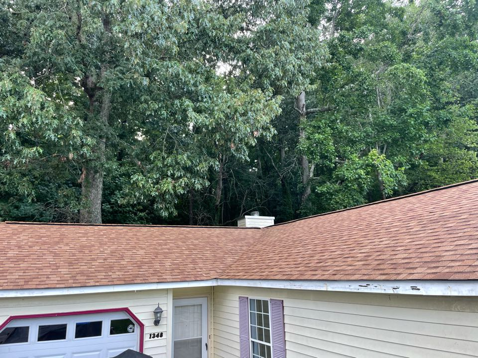 Virginia Beach, VA - Just completed a new roof installation using Owens Conning Duration HD lifetime warranty color desert tan with underlinement of U20 Felt Buster High Traction synthetic roofing felt and cobra rigidvent3 for more air air flow in the house