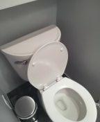 Memphis, TN - Adjust fill valve in bathroom toilet