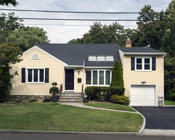 Scarsdale, NY - CertainTeed Light Maple Cedar Impressions vinyl siding on front of house and Monogram clapboard vinyl siding on sides and rea, with White trim and Black Mid-America panel shutters, and a GAF Timberline HD architectural roof in Charcoal