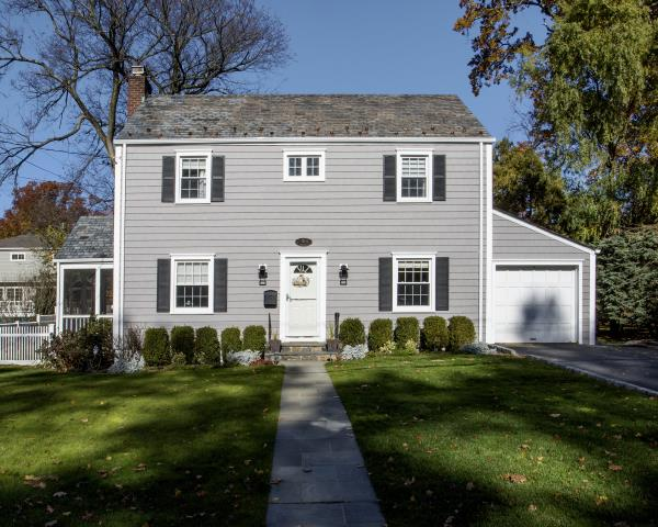 New Rochelle, NY - CertainTeed Cedar Impressions vinyl siding in Granite Gray with White trim, crown mouldings, front entry door fluted pilasters and decorative mantel, and MidAmerica Black louver shutters