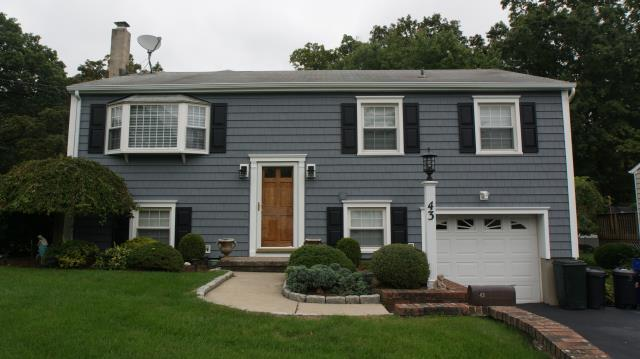 Norwalk, CT - CertainTeed Cedar Impressions vinyl siding in Flagstone