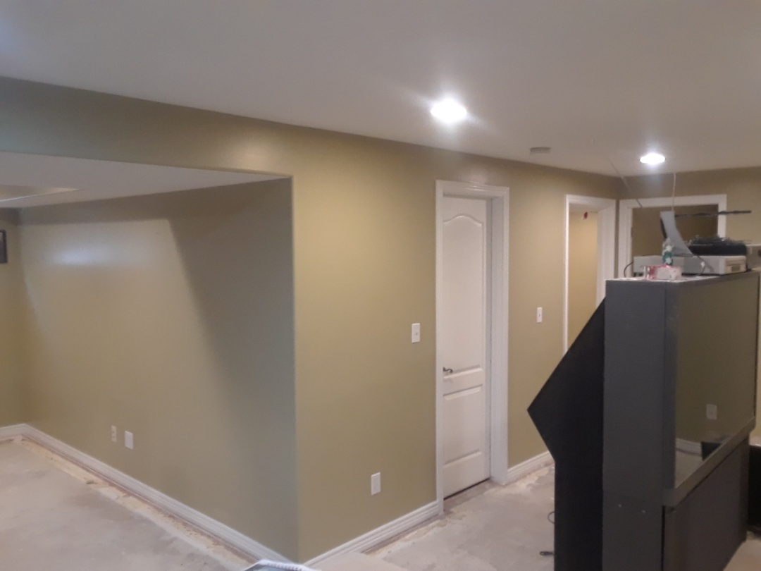 Finished painting walls in the basement due to a flood.
