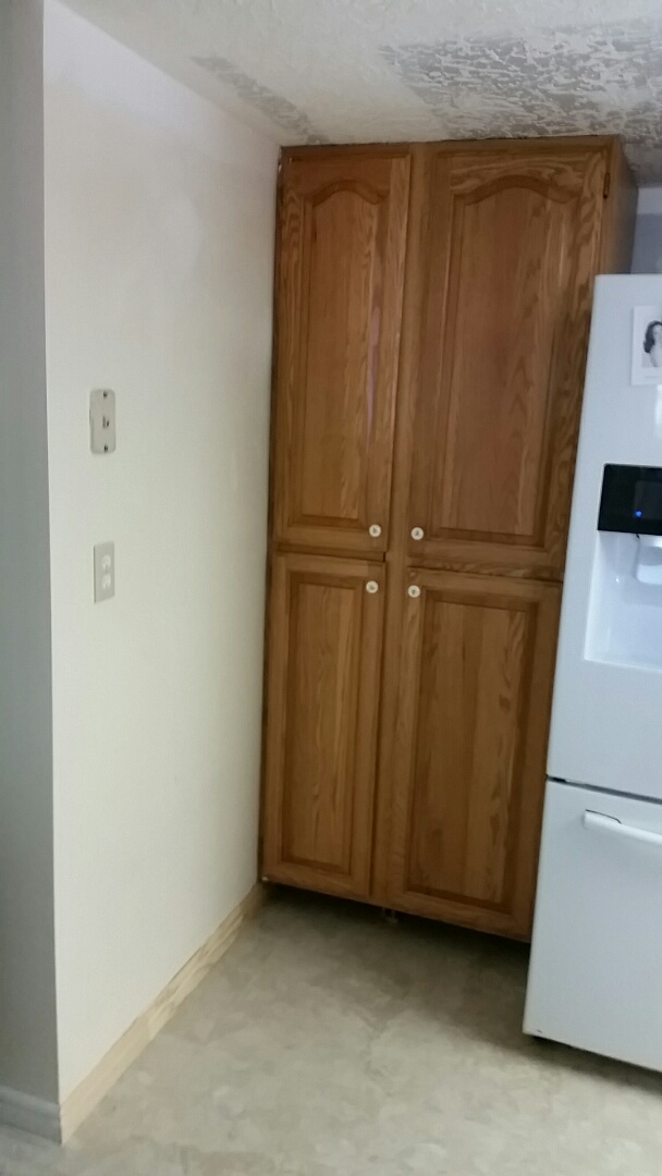 Install kitchen cabinets base and case due to flooding an upstairs bathroom