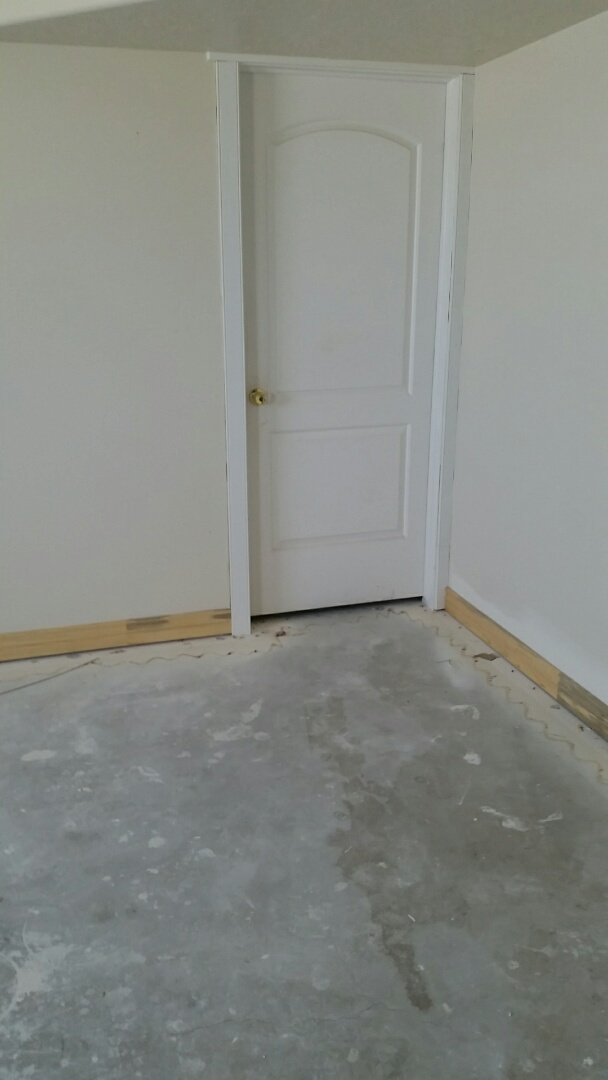 Installed baseboards and door casing . Due to flood