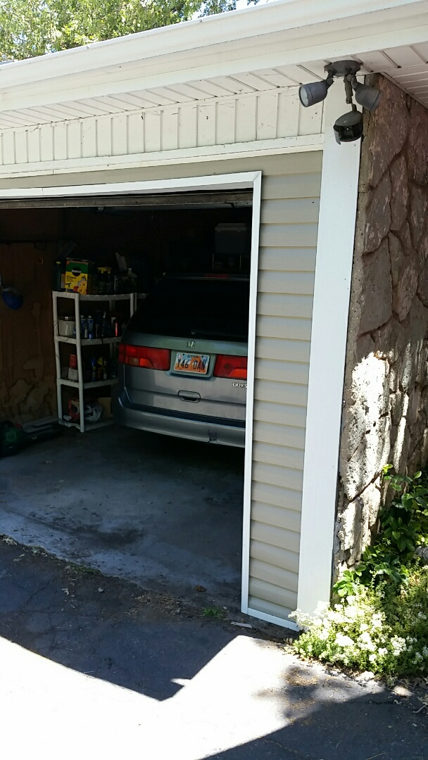 Installed New Garage Wrap and House Siding . Due to a Automobile Accident.