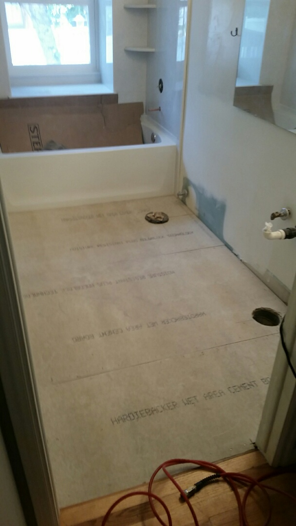 Installed sub-floor and tile backer board in bathroom due to water damage