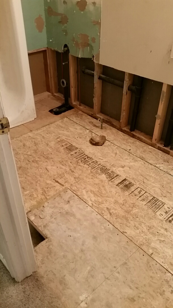 Demoed old sub-floor in bathroom and replaced with new . Due to water damage