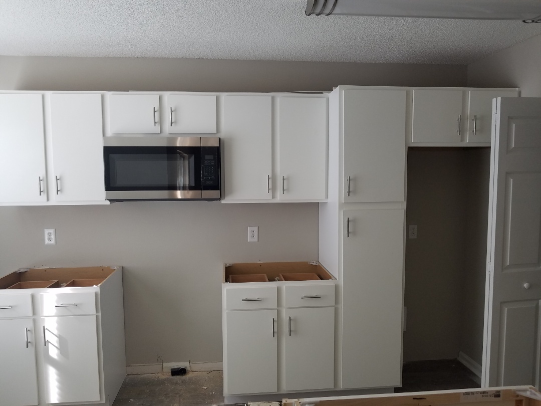 Spanish Fort, AL - discussing gray shaker style cabinets and a tile shower
