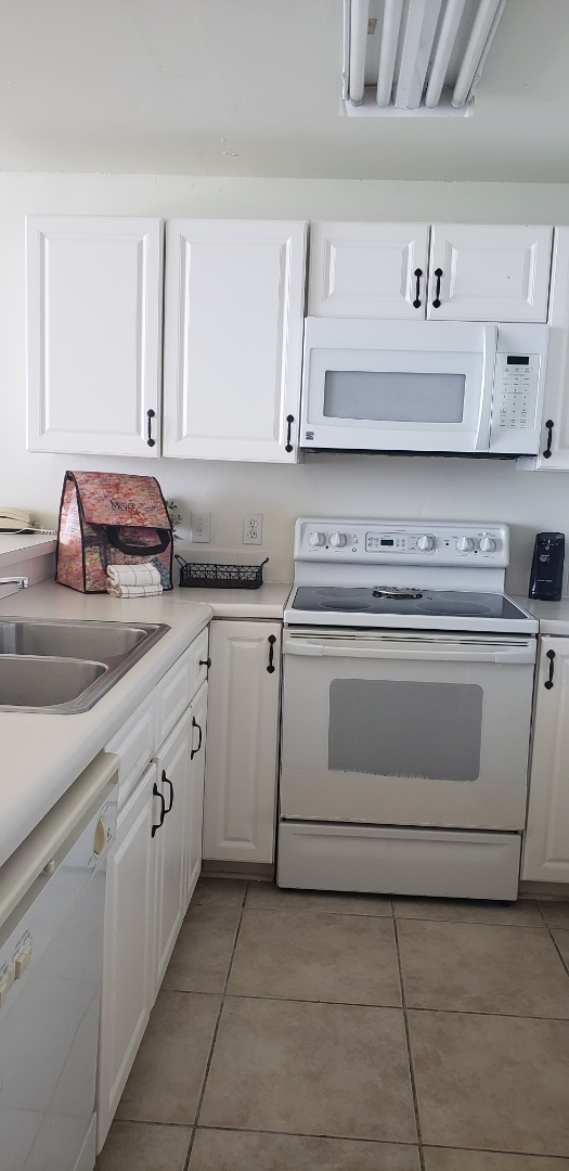 Condo remodel. Customer needed to replace cabinets and countertop in the kitchen area and bathroom. New bathtub with surround walls. New appliances.
