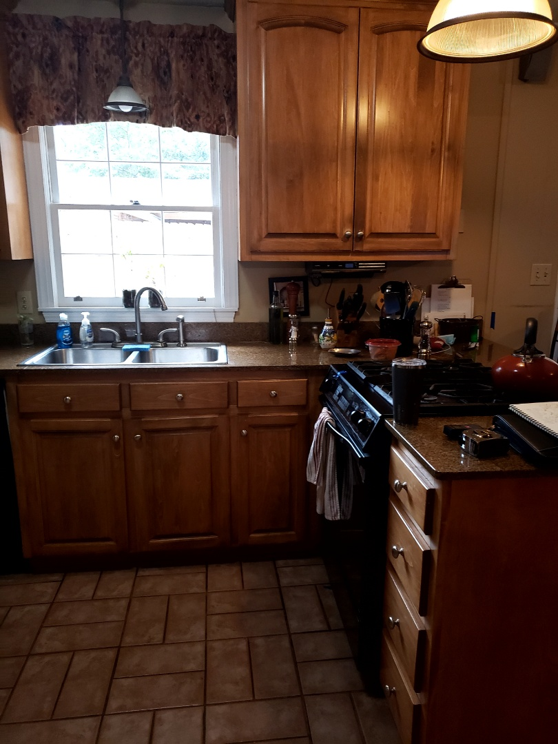 Kitchen remodel new layout with new appliances, custom made cabinets, countertop new LVP.