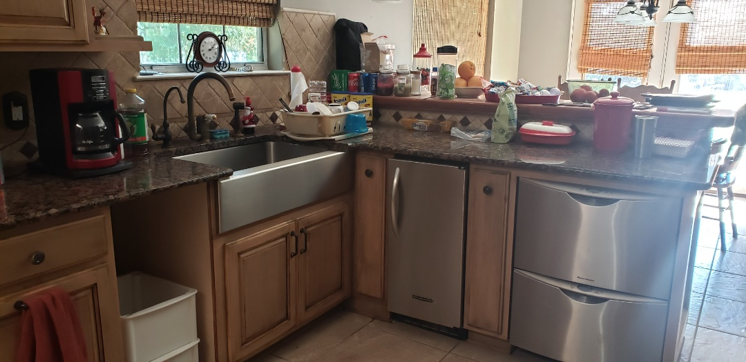 Kitchen and Bath remodeling. New cabinets replacement for storm damage. Wood custom cabinets and backsplash. New Onyx shower