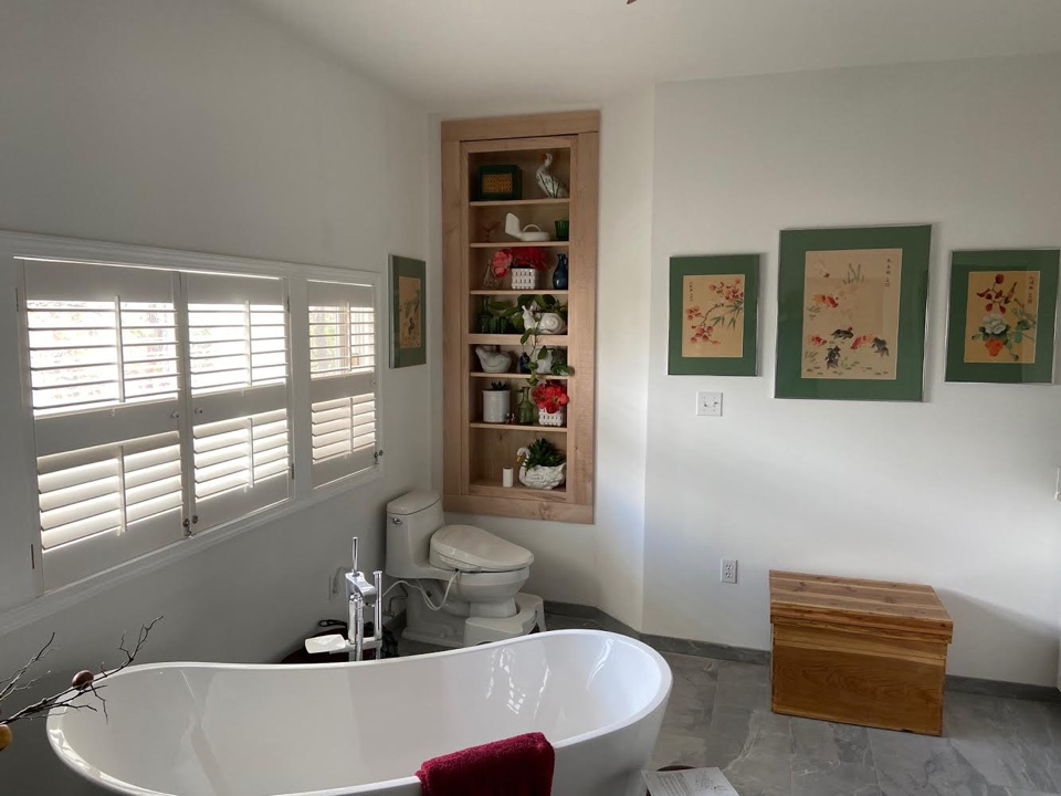 Pensacola, FL - Bathroom remodel on the coast. New tile floors, tub and built in bookcase.