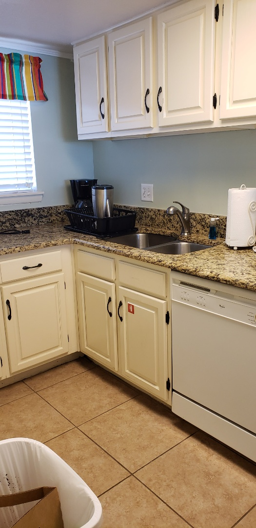 Condo kitchen remodel. New white shaker style cabinets with New appliances. Update lighting with recessed lights. Granite countertop and New subway tiles backsplash to match countertop color palette.