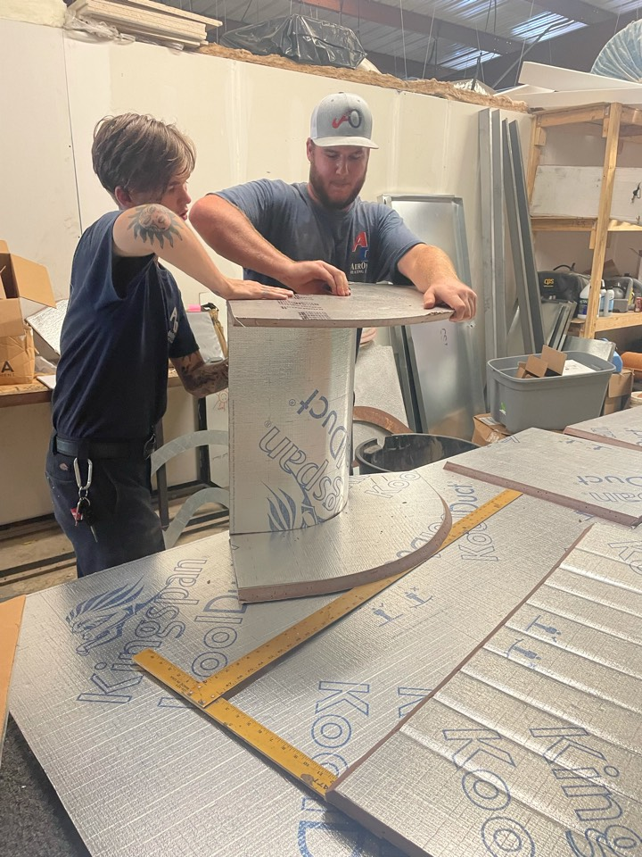 San Marcos, TX - Our duct fabrication experts building a Koolduct transition