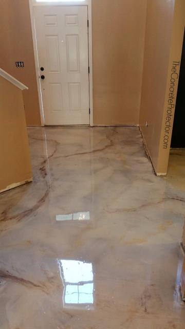 Rockford, IL - We just love how this marble floor turned out! The color combinations are phenomenal!! Xtreme Clean & Coatings are truly professional artists when it comes to decorating concrete floors!! The result couldn't be any more perfect than what it is now!! I would give them a 1000 star review if I could lol, but a 5 star is good too!!