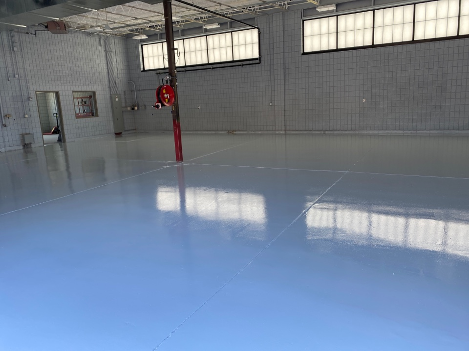 Dubuque, IA - This is the 1st urethane coat down for this concrete resurfacing job. Near Dubuque Iowa.
