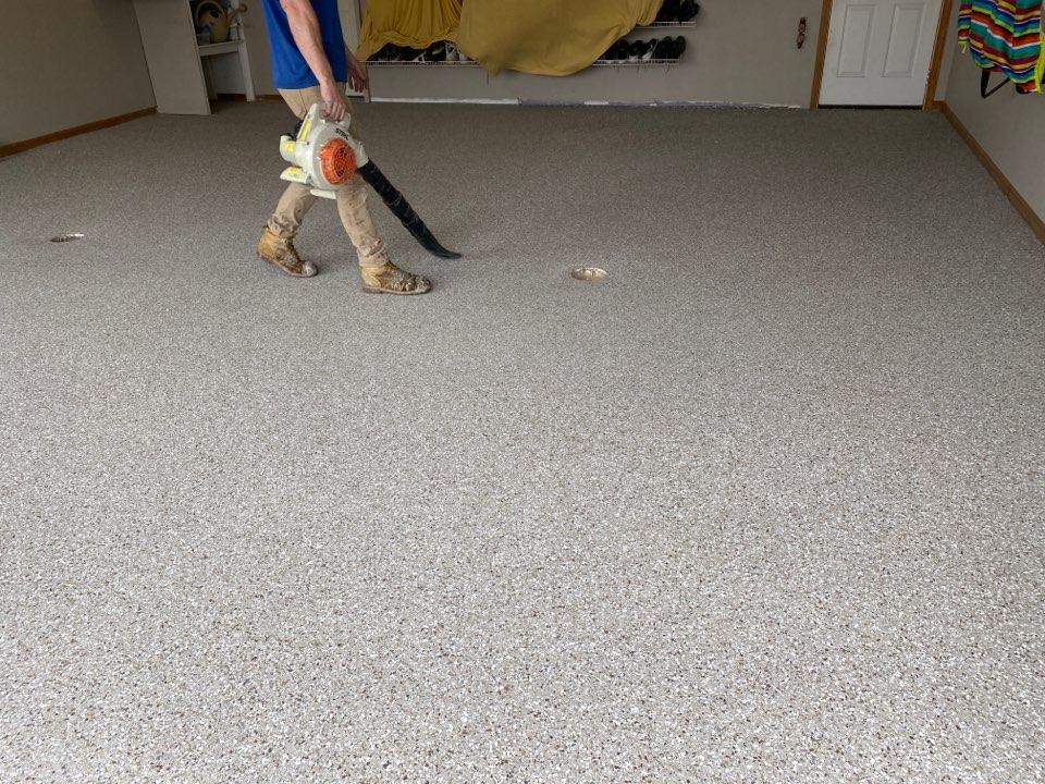 Dubuque, IA - We are finishing up this Polyurea chip flake concrete floor. Near Dubuque Iowa