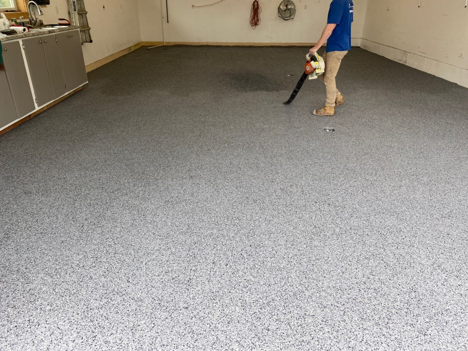 Dubuque, IA - Another polyurea chip flake floor being finished by the team. Near Dubuque Iowa