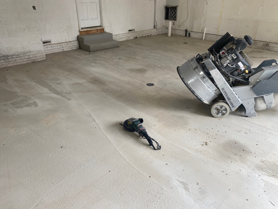 Dubuque, IA - The crew is getting ready for a chip flake floor concrete resurfacing job. Near Dubuque Iowa.