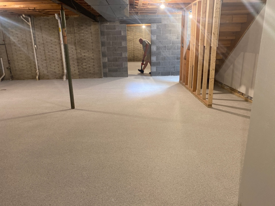 Dubuque, IA - Basement floor ready to be top coated. Really nice stone color flake schist marble concrete coating. Near Dubuque Iowa