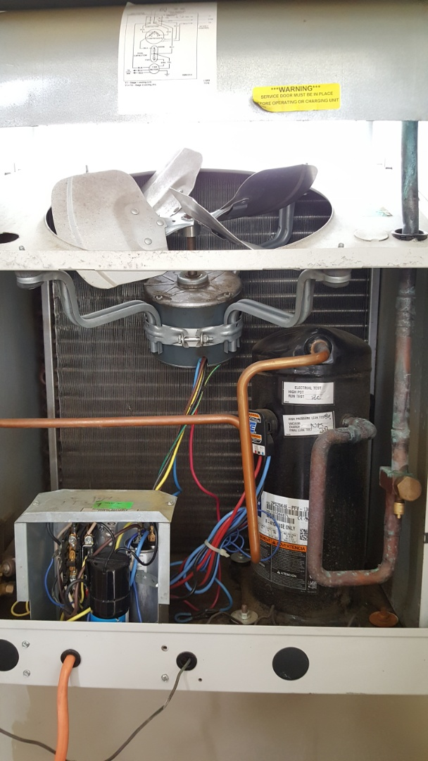 Vienna, VA - Performing routine service maintenance on condo unit. Checking operations and charge