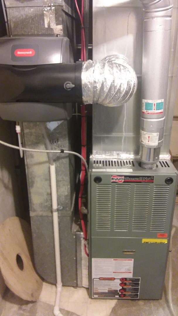Calgary, AB - Rudd furnace service call. No heat, replaced faulty Rudd flame sensor.