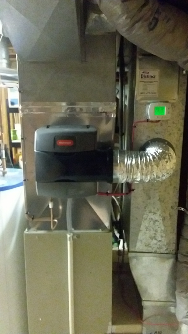 Calgary, AB - Kenmore furnace service. Install new Honeywell Advanced Bypass whole home humidifier.