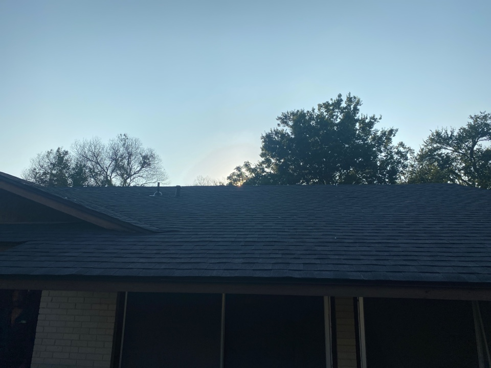 Austin, TX - Inspecting completed residential roof replacement for quality assurance and warranty certification