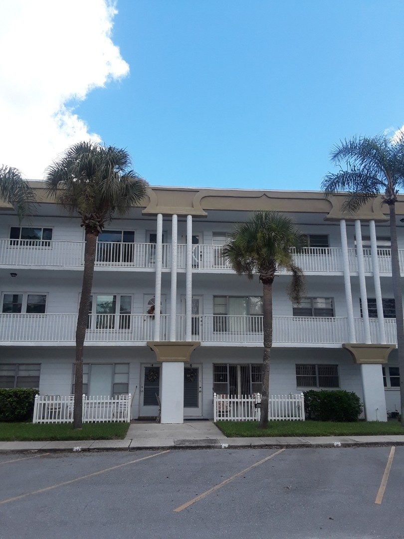 Clearwater, FL - At Top Of The World Condominiums Cleaning Carpet and Cleaning Furniture.