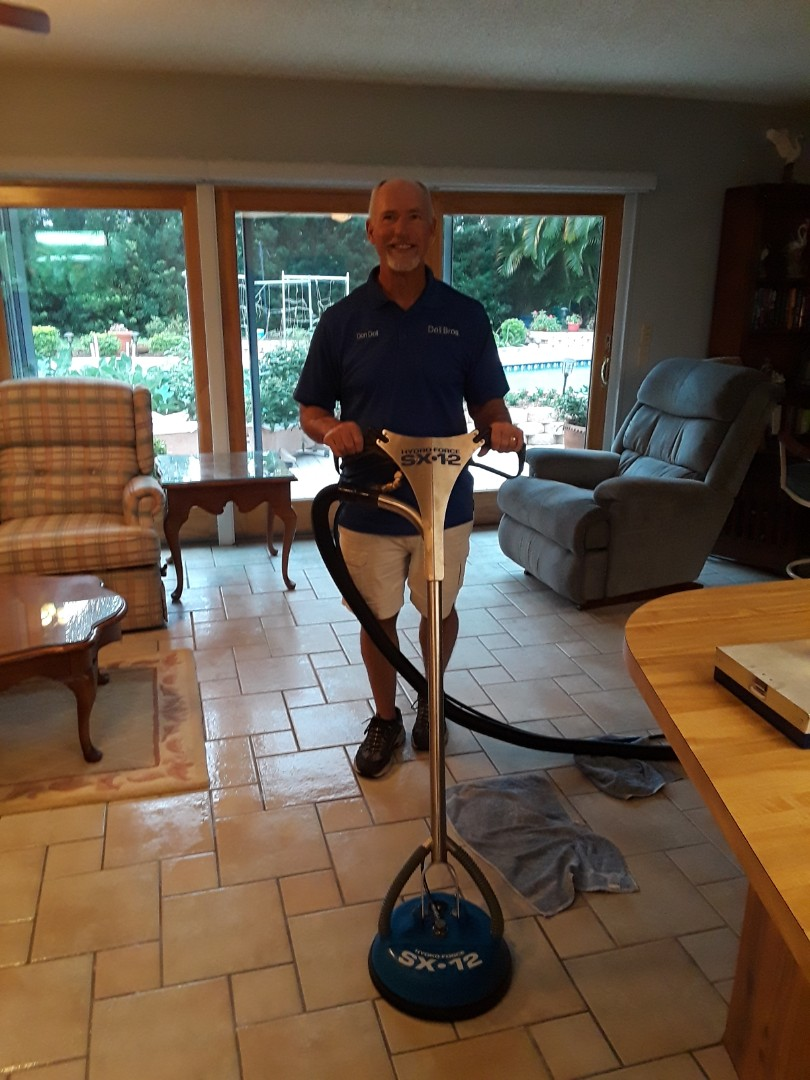 Seminole, FL - We have both trucks and the whole crew at this home. She said many people referred us to her. We are Carpet Cleaning some rooms and Tile and Grout Cleaning a large steak of floors.