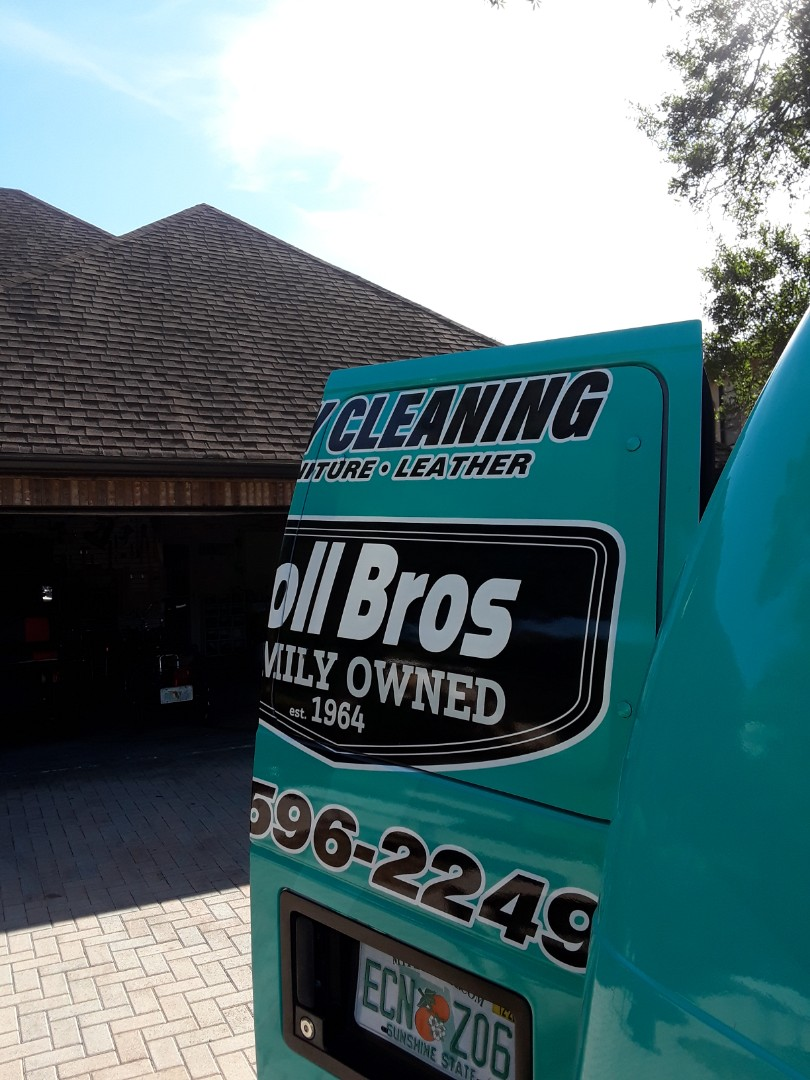 Both trucks are at this big home Cleaning Carpet throughout.