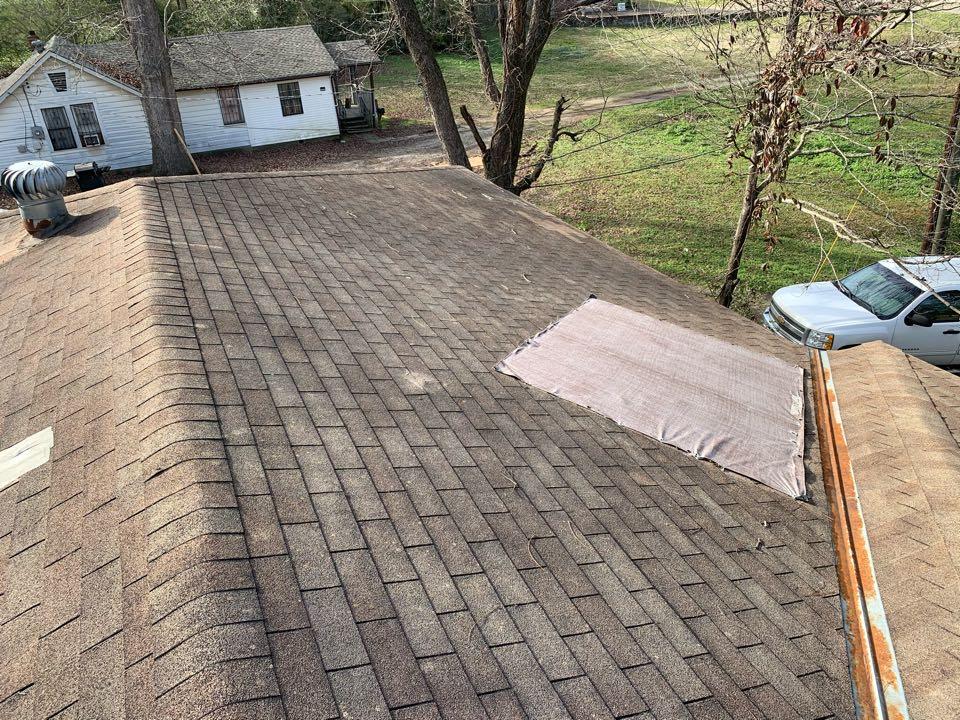 Midfield, AL - Measured to replace three tab shingle roof.