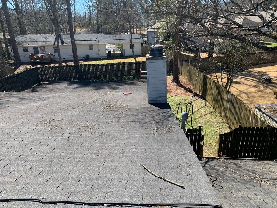 Birmingham, AL - Measured to repair leaking flat roof and replace chimney cap.