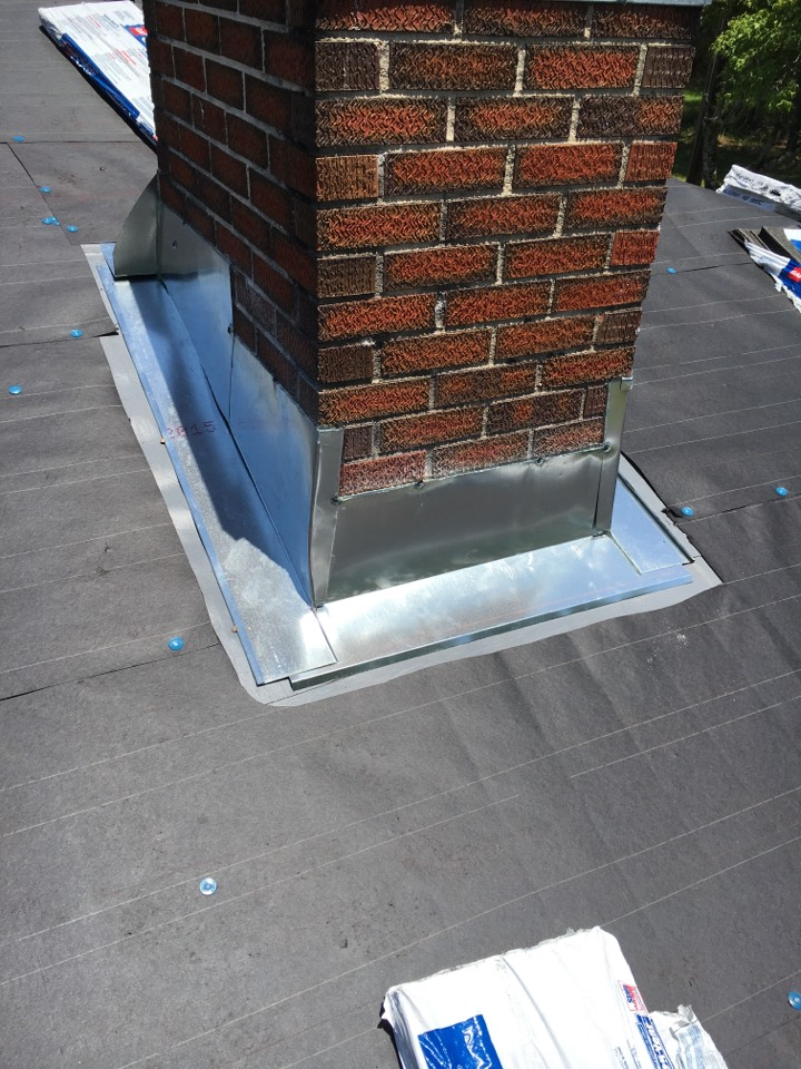 Harpersville, AL - A new galvanized flashing system on this chimney during a roof installation.