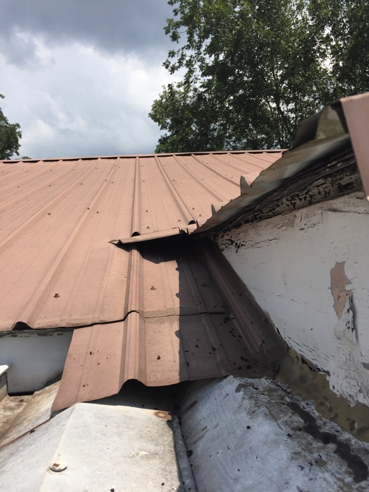 Birmingham, AL - Checking for leaks at a metal roof