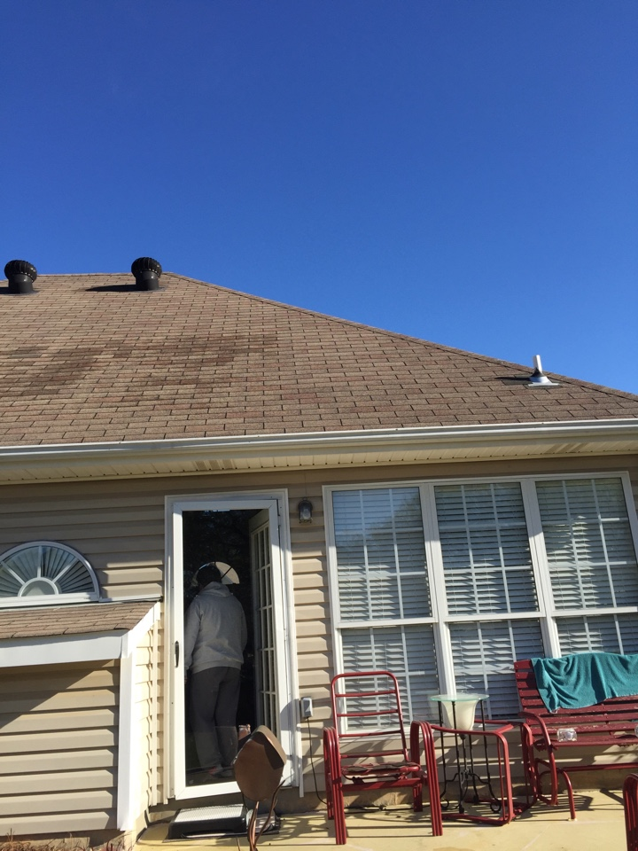 Calera, AL - Checking for storm damage on the roof