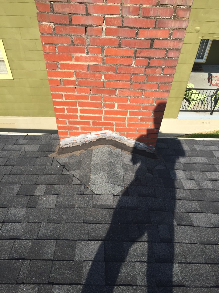 Birmingham, AL - Checking for roof leaks at a chimney