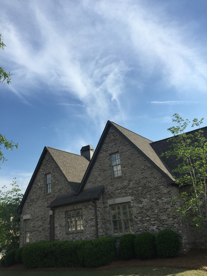 Birmingham, AL - Checking for roof leaks at a chimney cap