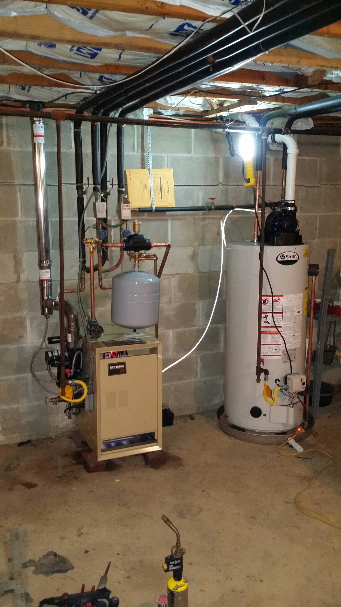 Toms River, NJ - New hot water boiler installation and hot water heater installation.  Install new gas fired Weil Mclain CGI5 boiler and A.O. Smith power vent water heater in Toms River NJ
