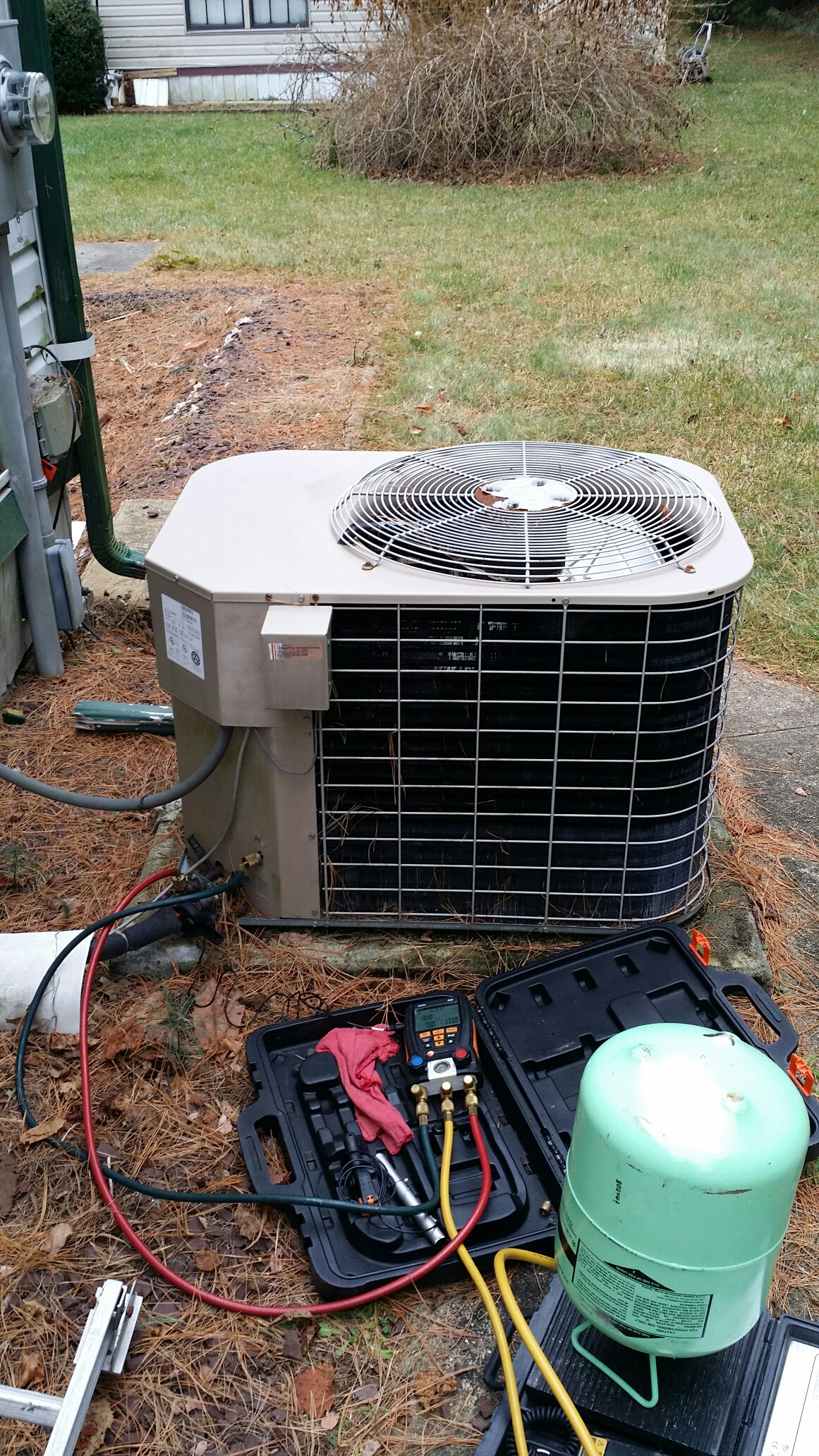 Freehold, NJ - No heat repair call. Mobile home Coleman heat pump not working. Replace start capacitor and charge unit with Freon R22.