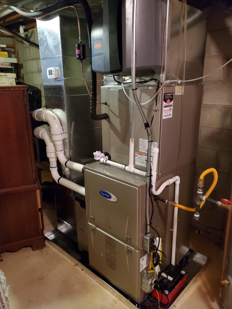 Install new Carrier performance gas furnace and 16 seer performance air conditioner