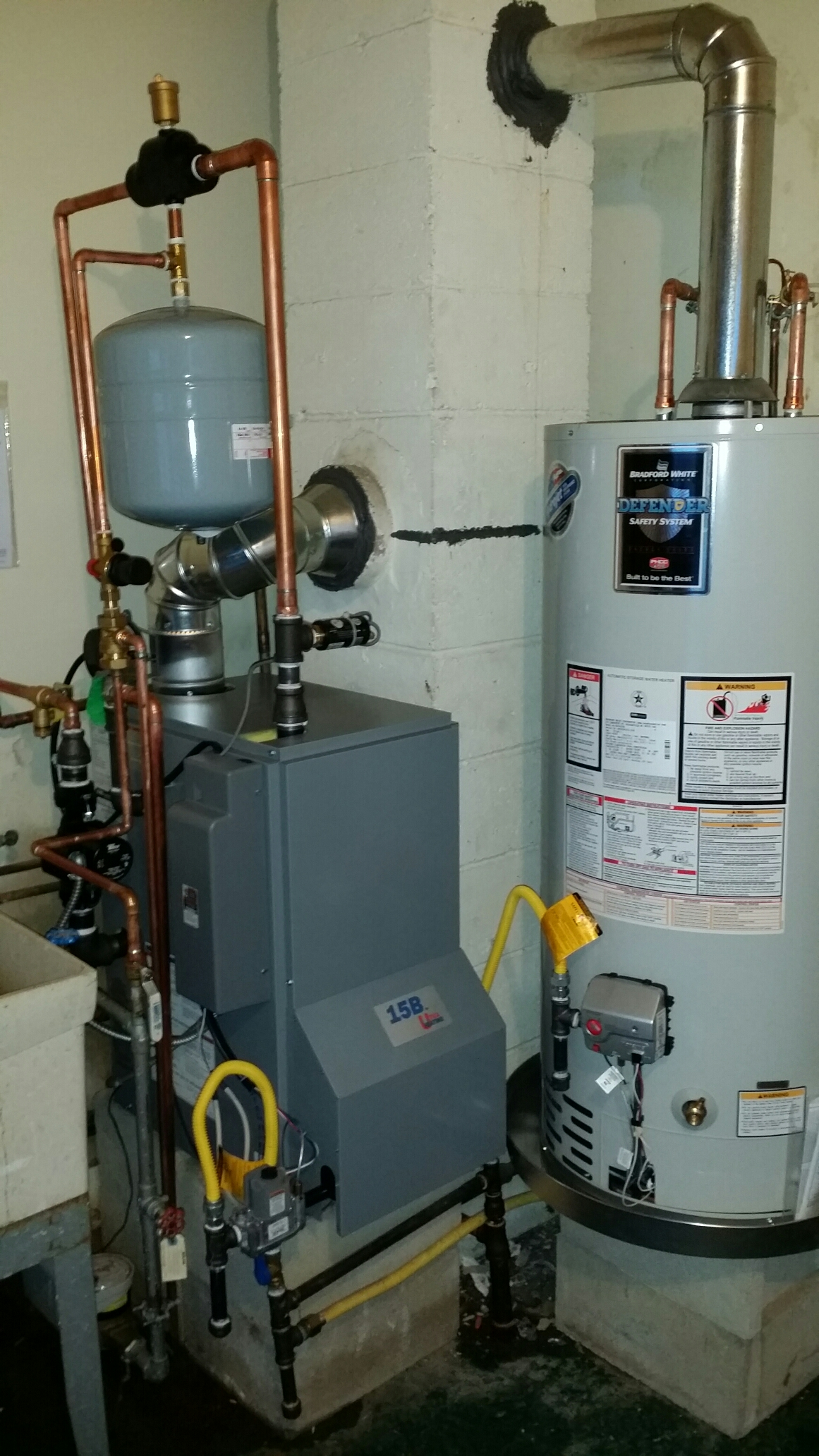 Toms River, NJ - Install new gas boiler system. Install Utica UB15 gas boiler and Bradford White 40 Gallon gas water heater.